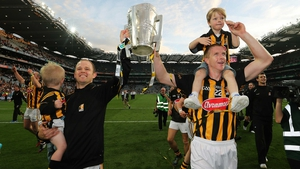 Tommy Walsh with his son Finn and Henry Shefflin with his son Henry celebrate after the final whistle in the 2014 All-Ireland hurling final replay