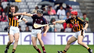 Michael Kavanagh and Tommy Walsh of Kilkenny tackle Niall Healy of Galway