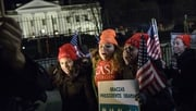 Immigration activists celebrate on Pennsylvania Avenue outside the White House