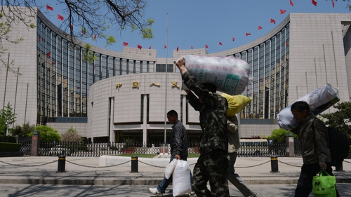 People's Bank of China cuts its reserve requirement ratio