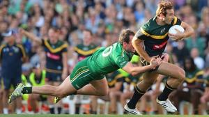 Australia's Jobe Watson and Michael Murphy of Ireland