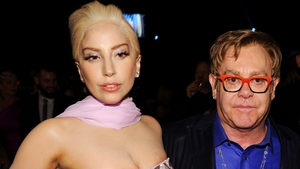 Elton John with Lady Gaga, one of the stars paying tribute on two new albums