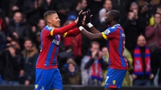 Palace's Dwight Gayle celebrates his goal with Yannick Bolasie