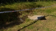 The boy was found in a drain along a highway in western Sydney