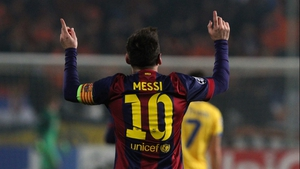 Lionel Messi celebrates after scoring his second goal for Barcelona