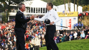 Then Europe Vice Captain Darren Clarke (L) shakes hands with Ian Poulter during the 2010 Ryder Cup