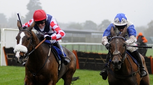 Tony McCoy riding Southfield Royale (L) clears the last to win on his return from injury