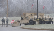 Armoured Humvees of the Missouri National Guard sit at a perimeter post outside a Target department store near Ferguson