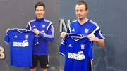 Ipswich Town signings Sean St Ledger (L) and Noel Hunt pose with their jerseys. Pic:@Official_ITFC