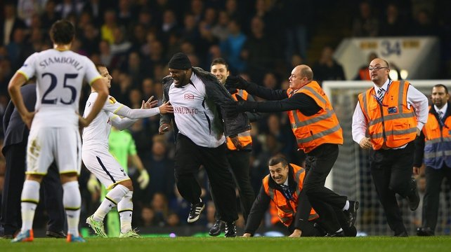 Pitch invaders mar Spurs victory