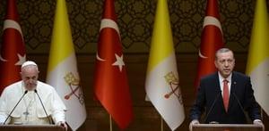 Pope Francis listens to the speech of Turkish President Recep Tayyip Erdogan during their meeting in Ankara