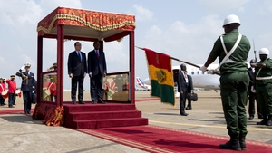 French President Francois Hollande with his Guinean counterpart Alpha Conde at Conakry airport