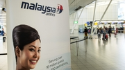 An advertising banner for Malaysia Airlines at Schiphol Airport, near Amsterdam