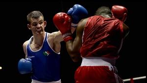 Adam Nolan (blue) in action against Daouda Sangare