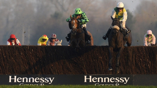 Leighton Aspell riding Many Clouds (R) clear at the last to win The Hennessy Gold Cup from Houblon Des Obeaux