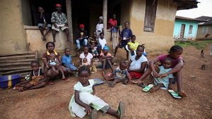 People under quarantine due to the death of over 20 locals from Ebola gather in Jene Wonde, Liberia