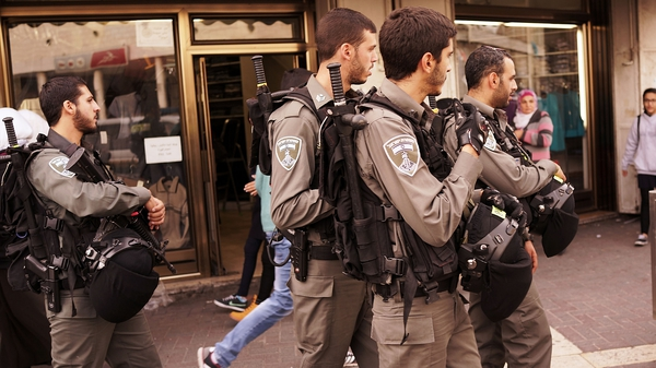 Soldiers walk the streets of Jerusalem