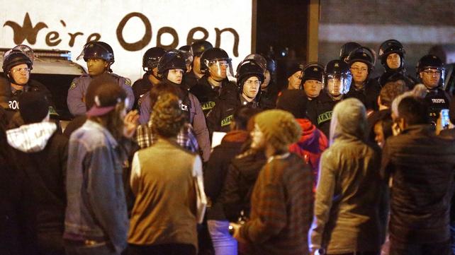 Police square off across from demonstrators in Ferguson
