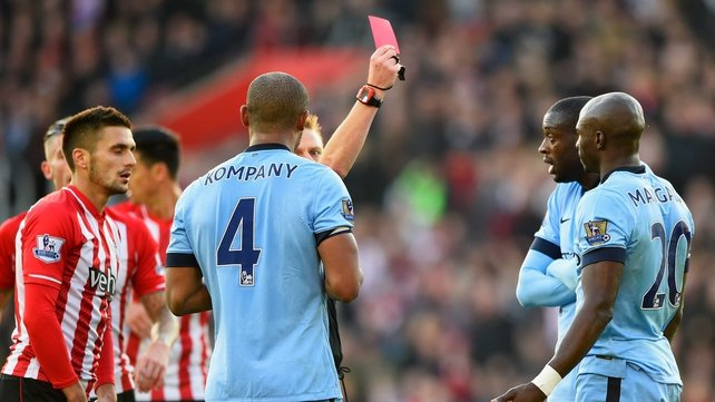 Eliaquim Mangala of Manchester City (20) is shown a red card by referee Mike Jones