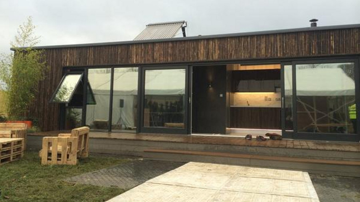 Shipping container adapted as family home