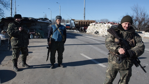 Pro-Russian rebels standing guard near the airport in Donetsk