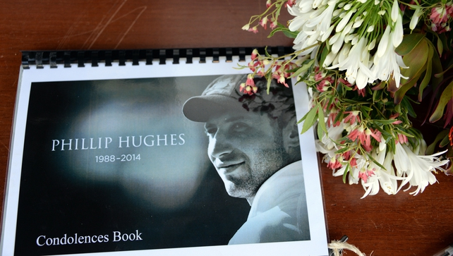 A condolence book at a remembrance ceremony for the late Australian cricket player Phillip Hughes in his hometown Macksville