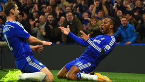 Didier Drogba takes the plaudits after he netted Chelsea's second against their London rivals