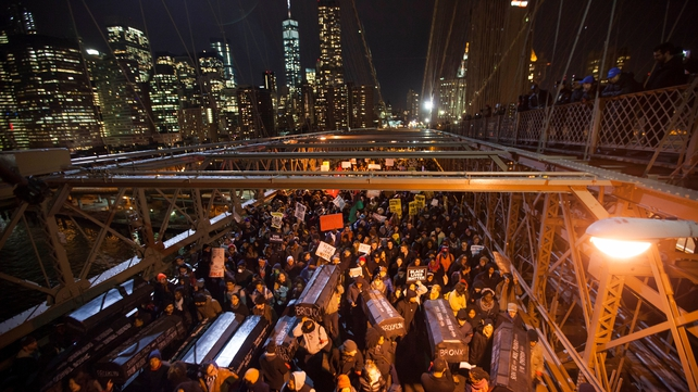 Protesters march over the Brooklyn Bridge