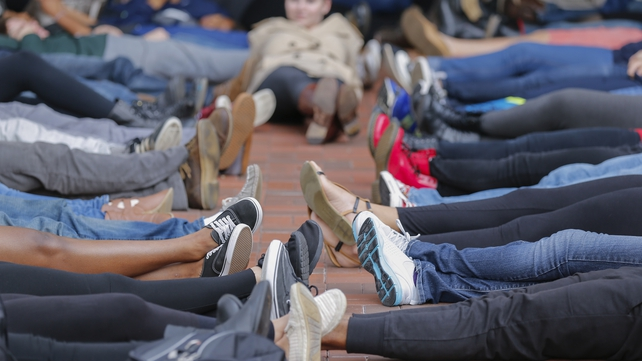 Students at Emory University participate in a mass 'die in' during a protest on campus