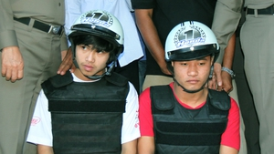 The suspects attend a press conference with police on the beach of Koh Tao