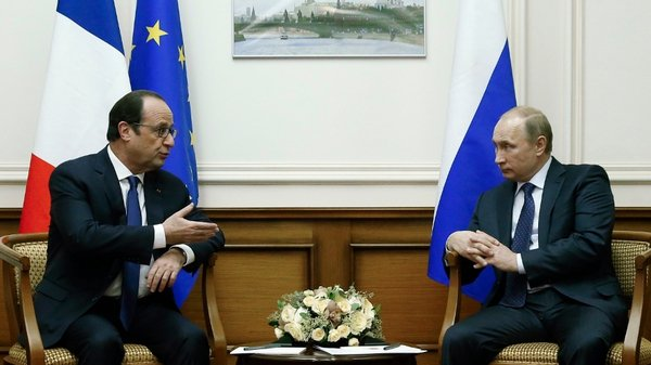 The French president stopped in the Russian capital on the way back home from a visit to Kazakhstan