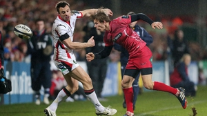 Ulster tryscorer Tommy Bowe battles with Scarlets' Liam Williams