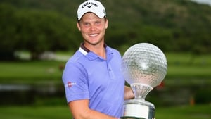 Danny Willett poses with the Nedbank Golf Challenge trophy