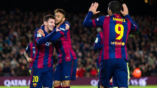Hat-trick man Lionel Messi is hugged by Neymar as Luis Suarez comes to celebrate too