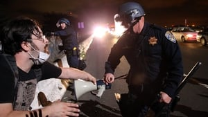 A California Highway Patrol officer confronts a protester who was blocking interstate 80