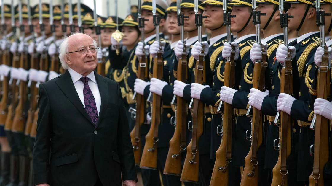 Image - President Michael D Higgins inspects a guard of honour during a visit to China in 2014