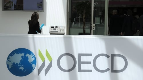 The OECD trimmed its outlook for this year as growth slows in many emerging countries
