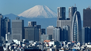 Japan's economy grew at a 1.3% annualised rate in the third quarter, down from the 2.2% growth first estimated