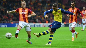Lukas Podolski slots home Arsenal's fourth in Istanbul