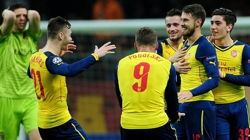 Arsenal's Aaron Ramsey celebrates with team-mates after scoring his second goal