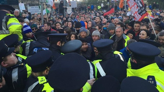 Gardaí reinforced the barriers to stop protesters pushing through