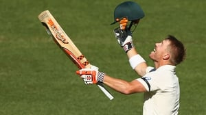 David Warner of Australia celebrates his second centruy of the first Test match between Australia and India