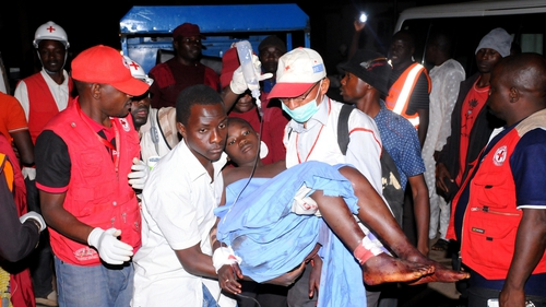 Rescue workers carry an injured victim of Jos bomb blast to Plateau State Specialist Hospital
