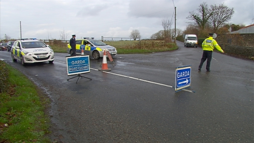 The road at the scene of the crash in Kerry is closed to facilitate an examination by garda forensic collision investigators