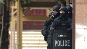 Armed police outside the café