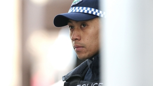 A police officer stands guard in the CBD