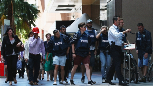 People are evacuated from the CBD as the hostage situation unfolds