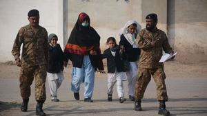 Children are led to safety from the Army Public School