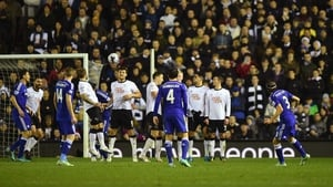 Filipe Luis guides his free-kick over the Derby wall to open his account for Chelsea