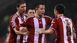 Masked man Marc McNulty celebrates his goal with his Sheffield United team-mates